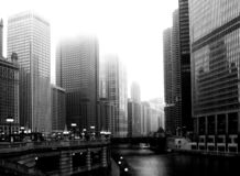 Downtown Chicago under thick fog with skyscraper office towers stock images