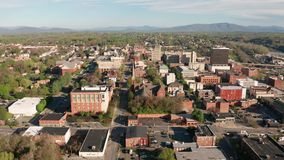 Bright Sunny Daylight Sky Aerial Perspective Downtown Lynchburg Virginia. Downtown City Center Core Skyline and Buildings of Lynchburg Virginia stock footage