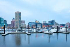 Downtown city skyline at the Inner Harbor in Baltimore. Baltimore, Maryland, United States – April 25, 2011: Downtown city skyline at the Inner Harbor and Royalty Free Stock Photo