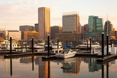 Baltimore downtown city skyline and Inner Harbor at dawn in Baltimore. Downtown city skyline and Inner Harbor at dawn, Baltimore, Maryland, USA Royalty Free Stock Photo