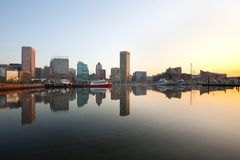 Downtown city skyline and Inner Harbor at dawn in Baltimore. Downtown city skyline and Inner Harbor at dawn, Baltimore, Maryland, USA royalty free stock image