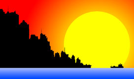 Downtown cityscape at sunset. Silhouette of a downtown cityscape at sunset Stock Photo
