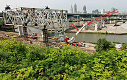 Downtown Cleveland behind construction. Cleveland is a major city in Ohio on the shores of Lake Erie. Landmarks dating to its days as a turn-of-the-20th-century stock images