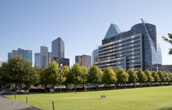 Downtown  Dallas has seen from Klyde Warren Park. Klyde Warren Park and modern buildings in city Dallas, TX USA Royalty Free Stock Photos
