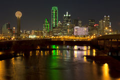 Downtown Dallas, Texas at night with the Trinity River Stock Photos