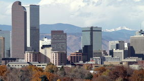 Downtown Denver Zoom Out. Slow zoom-out of the Denver, Colorado skyline, with City Park in the foreground. HD 1080p