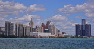 Downtown Detroit Skyline Stands Strong. Detroit waterfront basks in the summer sun Stock Photos