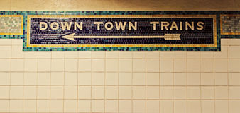 Downtown, Down Town train mosaic in the New York subway Stock Photos