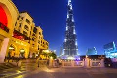 Downtown of Dubai with Burj Khalifa building at dusk. DUBAI, UAE - 1 APRIL 2014: Downtown of Dubai with Burj Khalifa building at dusk, UAE. Dubai is the most Royalty Free Stock Image