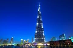 Downtown of Dubai with Burj Khalifa building at dusk. DUBAI, UAE - 1 APRIL 2014: Downtown of Dubai with Burj Khalifa building at dusk, UAE. Dubai is the most Royalty Free Stock Photo