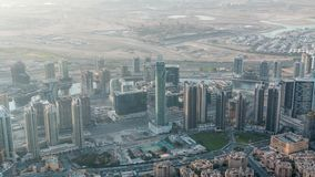 Downtown of Dubai in the morning timelapse after sunrise. Aerial view with towers and skyscrapers. Downtown of Dubai and Business bay in the morning timelapse stock video
