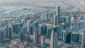Downtown of Dubai in the morning timelapse after sunrise. Aerial view with towers and skyscrapers. Downtown of Dubai and Business bay in the morning timelapse stock video footage