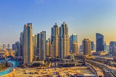Downtown Dubai cityscape. Sunny morning over Downtown Dubai under development on January 3, 2015 in Dubai, United Arab Emirates. It is a large development stock photo