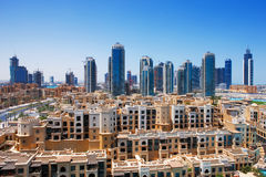 Downtown Dubai is dwarfed by the tall towers stock images