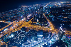Downtown dubai futuristic city neon lights and sheik zayed road. Shot from the worlds tallest tower burj khalifa Royalty Free Stock Photo