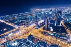 Downtown dubai futuristic city neon lights and sheik zayed road. Shot from the worlds tallest tower burj khalifa royalty free stock photo