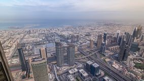Downtown of Dubai in the morning timelapse after sunrise. Aerial view with towers and skyscrapers. Downtown of Dubai in the morning timelapse after sunrise stock video footage