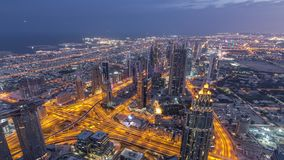 Downtown of Dubai night timelapse before sunrise. Aerial view with towers and skyscrapers stock video footage