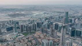 Downtown of Dubai night to day timelapse before sunrise. Aerial view with towers and skyscrapers. Downtown and Business bay in Dubai night to day transition stock video