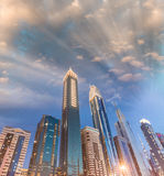 Downtown Dubai skyscrapers at night, skyward view Stock Image