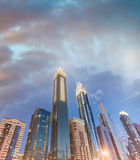 Downtown Dubai skyscrapers at night, skyward view Stock Images