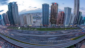 Downtown Dubai towers day to night timelapse. Aerial view of Sheikh Zayed road with skyscrapers after sunset. stock video footage