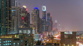 Downtown Dubai towers day to night timelapse. Aerial view of Sheikh Zayed road with skyscrapers after sunset. stock footage