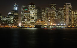 Downtown at dusk, San Francisco. A high-resolution stitched image of San Francisco downtown decorated by Christmas lighting at dusk (shot from Treasure Island) Royalty Free Stock Image