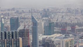 Downtown of Dubai in the morning timelapse after sunrise. Aerial view with towers and skyscrapers. Downtown and financial district of Dubai in the morning stock video footage