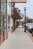 Downtown Fremont, Nebraska, Sidewalk with shops and signs and cars Stock Photo