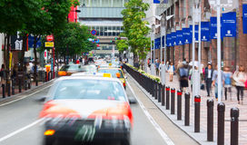 Downtown of Fukuoka city during peak time. Taxi cars aligned on the street. Fukuoka city, Japan. Stock Photography