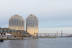 Downtown Halifax. Purdys Tower sits as the sun rises in Downtown Halifax. In the background you can see the Angus MacDonald bridge and the Canadian Navy base Royalty Free Stock Photography