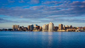 Downtown Halifax skyline at sunrise. View of downtown Halifax from Dartmouth with the waterfront and the Purdy`s Wharf. Halifax, Nova Scotia, Canada stock photo