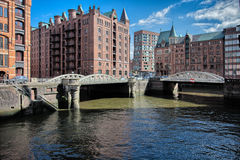 Downtown Hamburg On A Cloudy Day. Boats Passing On The Waterways. Stock Photos