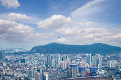Downtown of high rise  modern office buildings and skyscrapers i. N Seoul city with blue sky and cloud  from  top view in winter season, Seoul, Republic of Korea Royalty Free Stock Photo