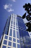 Downtown highrise under blue sky. Arched downtown highrise under blue sky Stock Photo