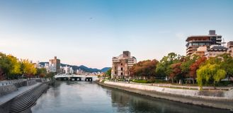 Downtown Hiroshima Cityscape at sunset in autumn, Japan. Hiroshima Cityscape at sunset on the side of Motoyasu River in Japan with the Peace Memorial Park on the royalty free stock photos