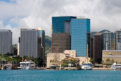 Downtown Honolulu. Skyline with boats and skyscrapers fronting Honolulu Harbor stock photo