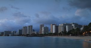 Honolulu Sunset Time Lapse. Downtown Honolulu and Waikiki Beach from Dusk to Night stock footage