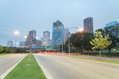 Houston Downtown from Allen Parkway at blue hour. Downtown Houston from Allen Parkway near Sabine street at blue hour. Highway/expressway in front of skyscrapers Royalty Free Stock Photos