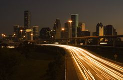Downtown Houston Behind Highway. View of downtown houston framed cars light on highway Royalty Free Stock Photos