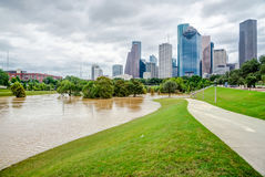 Houston Downtown Flood. Downtown Houston at daytime with pathway and rare high water flood on Eleanor Park by Harvey Tropical Storm. Heavy rains from hurricane stock photography