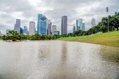 Houston Downtown Flood. Downtown Houston at daytime with storm cloud sky and rare high water flood on Eleanor Park because of Harvey Tropical Storm. Heavy rains royalty free stock images