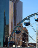 Downtown Houston. Ferris wheel and office buildings in downtown Houston, TX stock photo