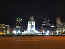 Downtown Indianapolis Indiana Skyline at Night. World War Memorial with downtown Indianapolis, Indiana in the background at Night in December stock photo