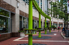 Downtown Indianapolis outdoor library. Indianapolis, Indiana  USA - Aug. 2016.  Street view of downtown Indianapolis with modern street signs and outdoor library Royalty Free Stock Images