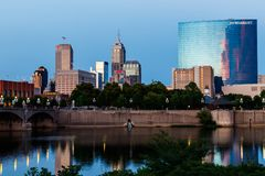 Indianapolis - Circa July 2018: Downtown Indianapolis skyline at sunset with Indy landmarks the Salesforce Tower and Marriott III Stock Photo
