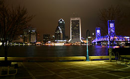 Downtown Jax. Night scene view of downtown Jacksonville on the water near the blue bridge Royalty Free Stock Images