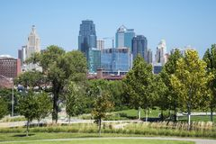 Downtown Kansas city Missouri USA skyline. With green trees in the foreground royalty free stock image