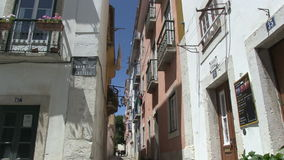 Downtown Lisbon, Portugal. Narrow alley in downtown Lisbon, Portugal stock footage